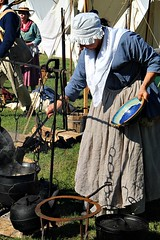 COOKING DINNER (MIKECNY) Tags: cook eat food 18thcentury woman apron kettle pot fire plate stir reenactment reenactor schoharie schoharievalley americanrevolution