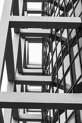 Door is upstair (PhlippeC.) Tags: géométrie geometric architecture monochrome noirblanc blackwhite vitres structure marne reims