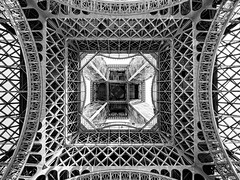 Dazzling steel monument (Marc Rauw.) Tags: paris monument monochrome metal architecture grid steel monumental blackandwhite white black france tower square blackwhite eiffeltower eiffel structure symmetry lookingup toureiffel symmetrical tall travel bw tourism engineering tourist attraction m43 microfourthirds μ43 dazzling olympus omd em5 mzuiko 1250mm mzuikodigital1215mm olympusomdem5 pattern fences famousplace building
