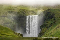 Iceland (My Planet Experience) Tags: skogafoss fall waterfall river water cloud people grass green landscape nature horizontal island iceland is myplanetexperience wwwmyplanetexperiencecom