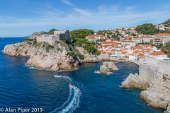 Dubrovnik seaward side (PapaPiper) Tags: dubrovnik citywalls sea castle bastion croatia europe sky seascape seal skyline boat cliffs blue terracotta