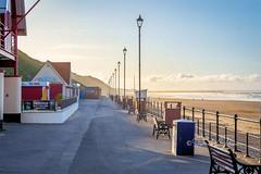 SJ2_1244 - Quiet times... (SWJuk) Tags: swjuk uk unitedkingdom gb britain england yorkshire northyorkshire yorkshirecoast saltburnbythesea promenade coast coastal seaside sea seascape lamposts bluesky hazy light sunlight evening sunset sand sanddunes beach landscape clouds nikon d7200 nikond7200 nikkor1755mmf28 2019 sep2019 autumn autumnal holidays rawnef lightroomclassiccc