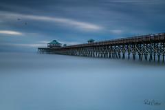 Pier in the Clouds (Reid Northrup) Tags: rrs nature atlanticocean beach bridge charleston follybeach longexposure nikon pier sand southcarolina surf water reidnorthrup sun clouds