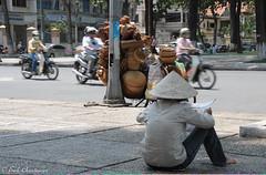 fb-20080324-D300-2522 (Erik Christensen242) Tags: hcmc saigon vietnam baskets bycicles color newspaper street vendor
