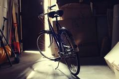 Old Triumph Bicycle (LensAdventurer) Tags: sonynex5n bicycle bike triumph garage backlight canon 28mm f28 english sturmeyarcher nottingham raleigh 3speed mood