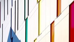 Urban Abstraction (No Great Hurry) Tags: abstractarchitecture minimal 18200 diagonal mondrian building architecture architectureontheslant london robinmauricebarr constructuralart nogreathurry canarywharf slanted windows colourful urban urbanabstraction