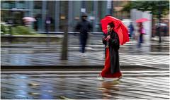 Oblivious (Fermat 48) Tags: manchester stpeterssquare mobilephone red umbrella wet rain reflection canon eos 7dmarkii ef24105mmf4lisusm tramtracks