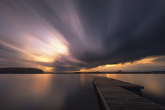 Dark clouds (Melanie Martinu) Tags: pier germany bavaria nature landscape refection light water lake autumn clouds sky sunset longexposure