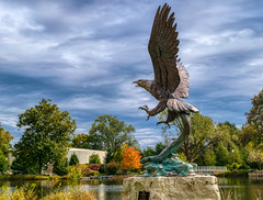 Fly like an eagle (tquist24) Tags: elkhart hdr indiana nikon nikond5300 outdoor wellfieldbotanicalgardens art autumn clouds color colorful eagle fall geotagged outside park pond reflection reflections sky statue tree trees water