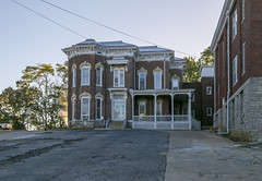 Cook House — Cynthiana, Kentucky (Pythaglio) Tags: house dwelling residence historic twostory brick ornate italianate polygonalbay cornice brackets 11windows keystones porch steps friezewindows slope parkinglot cables wires trees cynthiana kentucky harrisoncounty cook