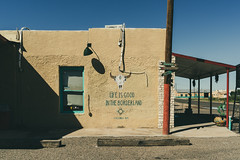 (el zopilote) Tags: columbus newmexico townscape street architecture mural smalltowns signs powerlines pentax k1ii hdpentaxfa35mmf2