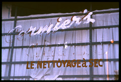2001-10 R03 003 (kccornell) Tags: cormiers dry cleaners nettoyage sec lafayette louisiana cajun french hand painted sign october 2001 35mm film slide e6 nikon fe2