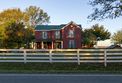 House — Broadwell Vicinity, Harrison County, Kentucky (Pythaglio) Tags: house dwelling residence historic farmhouse twostory brick blurry motionblur trees 11windows stone lintels sills porch altered remodeled fence integralgutter cynthiana kentucky harrisoncounty