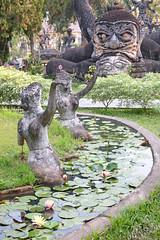 Pond Women (peterkelly) Tags: digital canon 6d asia southeastasia indochinaencompassed gadventures laos vientiane buddhapark xiengkhuan luangpubunleuasulilat statue statues pond water lilies waterlily women sculpture path trail
