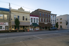 Buildings — Cynthiana, Kentucky (Pythaglio) Tags: street brick altered buildings structures historic commercial twostory brackets awnings cornice kentucky sidewalk cables wires italianate cynthiana harrisoncounty