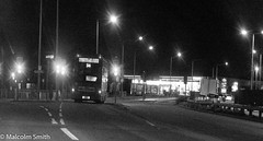 Route 34 Towards Walthamstow (M C Smith) Tags: monochrome pentax kp bus route 34 halllane chingford a406 northcircular railings road trafficlights lines lamps petrolstation busshelter signs weeds truck traffic moving junction
