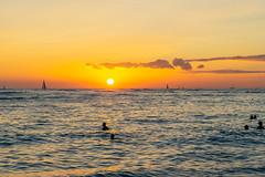 Waikiki Sunset lll (fate atc) Tags: hawaii kuhiobeach pacificocean sunset waikiki water boats surfing swimming yachts