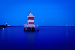 "Lignano - Red lighthouse (alecompa) Tags: water ""longexposure"" ""plustek7600i"" film ""kodakektar"" ""filmisnotdead"" italy ""bluehour"" ""lignanosabbiadoro"" lighthouse landscape sea"