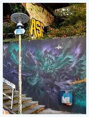 burst of blue (overthemoon) Tags: switzerland suisse schweiz svizzera romandie vaud lausanne ruenelsonmandela graffiti tags colourful eracom