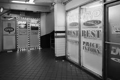Best Price in Town on DVD Movies (Zach K) Tags: 42nd street video store underground urban adultmovies adult movies dvds subways c e station port authority nyc fuji fujifilm xpro2 xf18mm storefront porn black white bw blackwhite