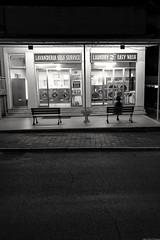 Waiting for the laundromat (Mario Ottaviani Photography) Tags: waiting laundromat lavanderia aspettare blackandwhite monochrome monocromo biancoenero blackandwhitephotography marioottaviani people persona