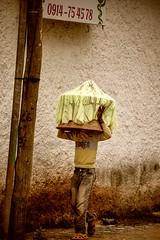 Injera Delivery (Rod Waddington) Tags: africa african afrique afrika äthiopien adigrat ethiopia ethiopian ethnic ethnicity etiopia ethiopie etiopian tigray tigrinya injera boy child delivery streetphotography street sign urban