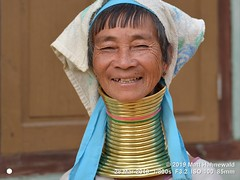 2015-11c Kayan Lahwi Burma 2019 (14a) (Matt Hahnewald) Tags: matthahnewaldphotography facingtheworld qualityphoto people head neck face expression lookingcamera smile tribal costume headscarf consensual conceptual diversity travel tourism respect dignity lifestyle impact exotic ethnic minority local rural traditional cultural touristattraction village panpet kayahstate myanmar burma asia asian person one female adult woman women nikond610 nikkorafs85mmf18g 85mm 4x3ratio resized 1200x900pixels horizontal street portrait fullfaceview closeup outdoor colour posing authentic sitting giraffewoman brassrings brasscoils kayan lahwi longneck padaung brass karen threequarterview smiling fringe bangs