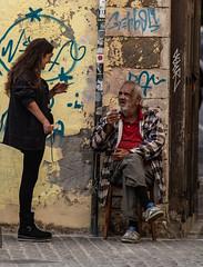 street corner (Binob0) Tags: street corner conversation smoking cigarette crete rethymnon life grafitti outside chat talking old beard