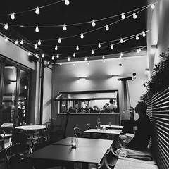 cluj (mennyj) Tags: cluj napoca romania transylvania travel work trip 2019 fall mobile iphone iphone11 wine bar outdoor alfresco string lights patio cute bw blackwhite scene man person kitchen kupaj silhouette