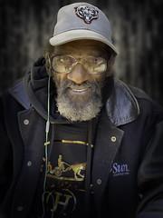 Mitchell (mckenziemedia) Tags: man portrait portraiture face smile hat baseballcap cap coat glasses homeless homelessness chicago city urban street streetphotography people humanity
