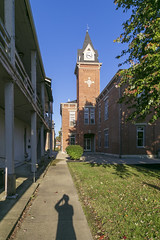 Pendleton County Courthouse — Falmouth, Kentucky (Pythaglio) Tags: courthouse building structure historic twostory brick 1848 1884 romanesque italianate corbelling corbelled tower stone lintels sills sidewalk pendletoncounty kentucky clocktower pilasters cornice brackets falmouth