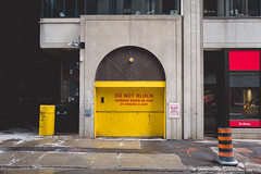 for.the.time.being (jonathancastellino) Tags: toronto architecture vernacular street door garage arch leica q series cbd