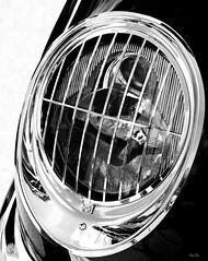 lite behind bars... (Stu Bo - Tks for 13 million views) Tags: highkey headlight bw blackandwhite chromeisking sbimageworks showcar canonwarrior classiccar coolcar certifiedcarcrazy details corvette sexonwheels vintageautomobile oldschool onewickedride