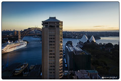 Dusk on the Harbor (Bob Shrader) Tags: olympuspenf olympusmzuikodigitaled12100mmf40ispro 15mm f63 1160sec 200iso raw microfourthirds mft m43 mirrorless oceania australia newsouthwales sydney circularquay architecture structure building apartmentbuilding quayapartments landmarks bridge sydneyharbourbridge publicbuilding sydneyoperahouse nature sky dusk water harbor sydneyharbor transportation ship tourship ferry skyline clouds penf zoomlens mzuiko12100mmf40ispro olympusmzd12100mmf40ispro exterior outdoors wideshot exposuresoftware exposurex5 skylum luminarflex on1 photoraw2020 photoborder photoedge photoframe postprocessing preset style