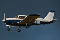 Photo of G-BTGO - Piper PA-28-140 Cherokee D lands at a stormy Oxford / London Airport .