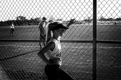 Warriors of the Diamond (alhawley) Tags: american bw usa abstract backlight baseball blackandwhite candid chainlink everytownusa grain gritty highcontrast monochrome ricohgrii softball street streetphotography chainlinkfence