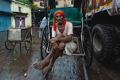 "Circle of life (Karunyaraj) Tags: circles tyre potrait worker stule pose kolkatta ""urbanlife"" redturban india indian monsoon rain d610 cwc cwc742 tokina1735"