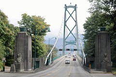 Lions Gate Bridge, Vancouver, BC (hannu & hannele) Tags: lionsgatebridge vancouver bc britishcolumbia canada bridge road highway trees columns statue sculpture nikon d700