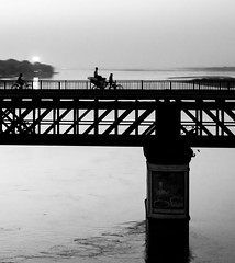 (KKB 13) Tags: light bw blackandwhite lines highlight black patterns pattern diagonal intersection geometry bridge person rickshaw people cycle silhouette india river water reflection sunset bnw pillar urban town city high contrast art visual