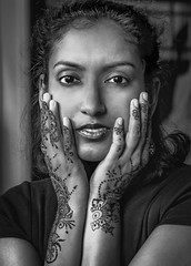 Henna Wonder (DJB Photo NYC) Tags: desigirl indiandiaspora westindianfaces trinigirl trinidadian blackandwhiteportrait gorgeous beautifulface tattoo browngirlsrock naturallightportrait facecradle hands sigma1835mm canont5i nycphotographer portrait headshot henna mehndi