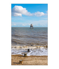 Three Hours in Dovercourt & Harwich, Essex, England. (Joseph O'Malley64) Tags: dovercourtlighthouses dovercourtlighthouse lighthouse dovercourt harwich essex essexcoast england sea northsea coast coastal beach maritime navigation navigationalaid victorian victorianstructure thebuiltenvironment newtopography newtopographics manmadenvironment manmadestructure building structure horizon shingle groynes waves hightide bluesky clouds fujix fujix100t architecture documentaryphotography britishdocumentaryphotography accuracyprecision seaside thebritishseaside