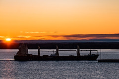 End of the Voyage Beginning of the day (langdon10) Tags: canada cargoship quebec stlawrenceriver sunrise water arriving port ship shoreline sun