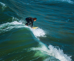 Catching A Ride (larwbuck) Tags: autumn california fall ocean person seascape water waves