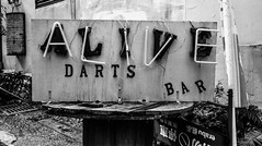 alive, darts bar (steve: they can't all be zingers!!! (primus)) Tags: contaxrts carlzeissdistagon35mmf28 agfaapx100 bw blackwhite monochrome taiwan taichungtaiwan