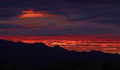 Sunset / Hualapai Mountains (Ron Wolf) Tags: clouds landscape mountain nature range sky sunset mohavecounty arizona