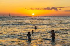 Kuhio Beach Sunset (fate atc) Tags: hawaii kuhiobeach pacificocean sunset waikiki water boats surfing swimming yachts
