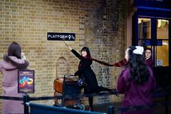 Platform 9 3/4 (DaDa 1127) Tags: london portrait people girl wall smile smiling happiness happy woman landmark uk snap travel railway rail station amazing magic harrypotter