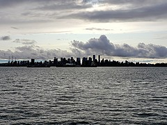 Moodyville (walneylad) Tags: vancouver britishcolumbia canada burrardinlet cityscape skyline downtown cbd urbancore portofvancouver pacificocean sea ocean water waves dark clouds bluesky city buildings ships harbour waterfront fall autumn afternoon october moody sky seaport light