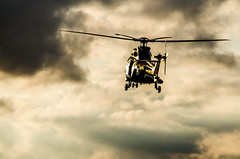 Cloudy Descent (Floris M. Oosterveld) Tags: helicopter cougar air force royal netherlands rnlaf koninklijke luchtmacht chopper training sunset sky stock military aviation nikon