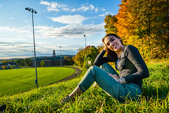 Lexi-217 (TheseusPhoto) Tags: girl female woman model modeling portrait portraiture artportrait artistic artisticportrait fineartportrait fineart light pose beautiful pretty lovely color autumn fall sitting smiling happy grass newengland outdoors building field sky clouds trees leaves nature